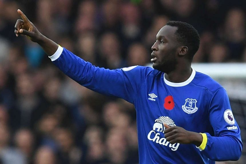 Everton's Belgian striker Romelu Lukaku celebrates after scoring the opening goal of the English Premier League football match between Everton and West Ham United at Goodison Park in Liverpool, north west England on Oct 30, 2016.