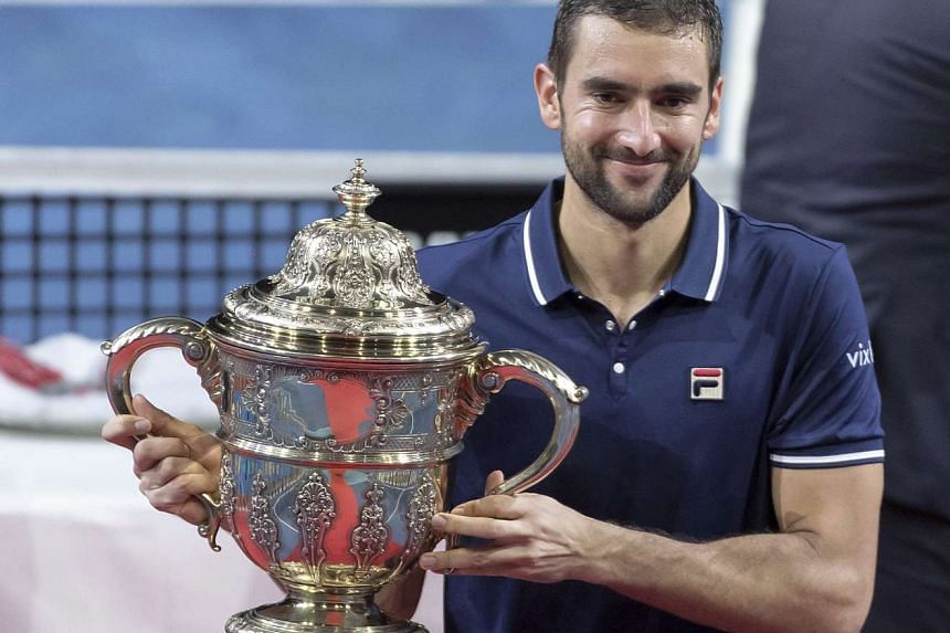 Croatia's Marin Cilic celebrates wining the final match against Japan's Kei Nishikori at the Swiss Indoors tennis tournament at the St. Jakobshalle in Basel, Switzerland, on Oct 30, 2016.