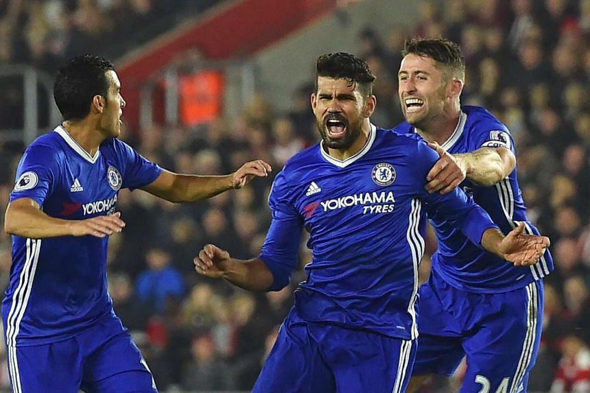 Chelsea's Brazilian-born Spanish striker Diego Costa (centre) celebrates scoring their second goal with Chelsea's Spanish midfielder Pedro (left) and Chelsea's English defender Gary Cahill (right) during the English Premier League football match betw