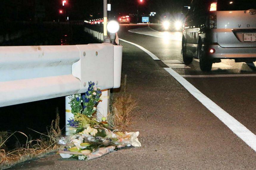 Flowers are seen on Aug 24, 2016, near the scene where a passer-by was killed after being hit by a driver playing Pokemon Go while driving in Tokushima, Japan.