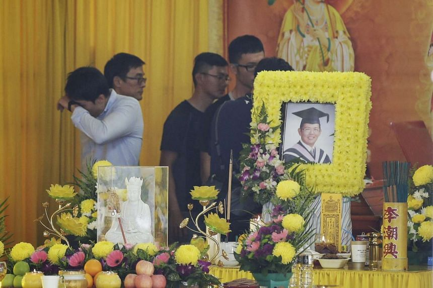 Friends at the wake of Mr Koh Kah Wei, a 30-year-old who fell into a river while kayaking in Perak, at Anchorvale Drive on Oct 31, 2016. He was with a group of friends last Saturday when his kayak hit driftwood and overturned.