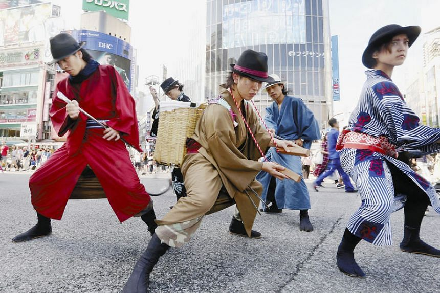 Members strike a pose to the sound of wooden clappers in Shibuya Ward, Tokyo.