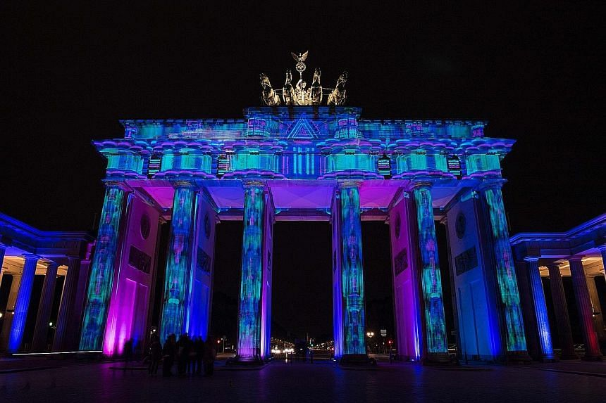 The Brandenburg Gate lit up during the Festival of Lights earlier this month. Berlin's vibrant scene is a draw for tech start-ups.