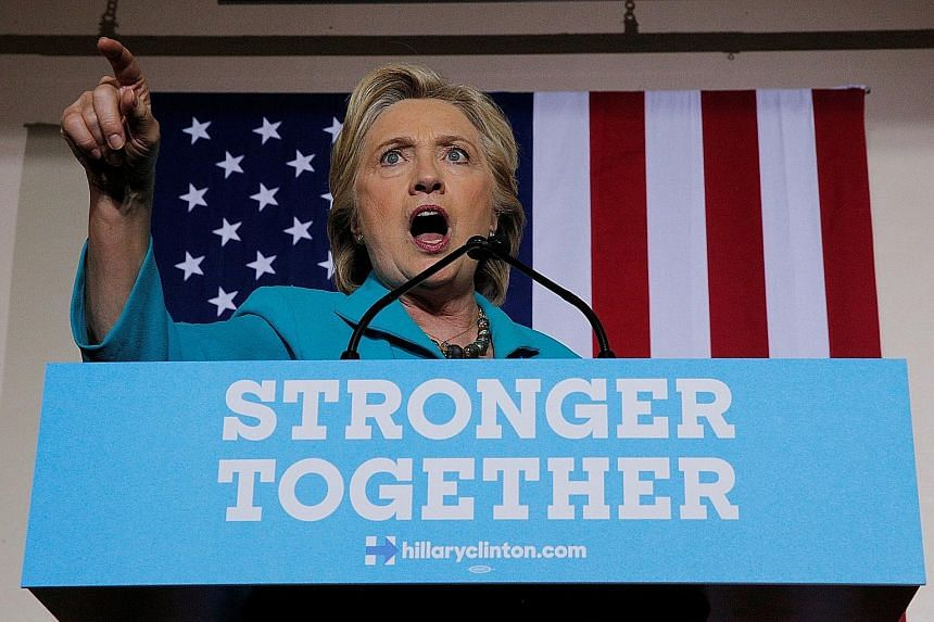 Mrs Clinton at a rally yesterday in Daytona Beach, Florida, where supporters rallied around her, booing as she mentioned the letter sent by FBI director James Comey to Congress last Friday. The day before, the Justice Department strongly discouraged