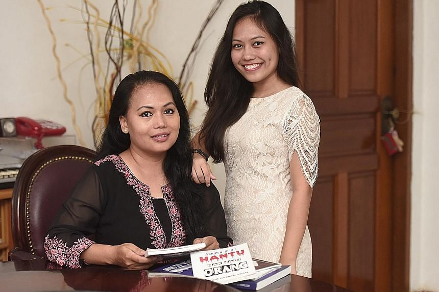 Poet and writer Noor Hasnah Adam (left) and her daughter, budding short-story writer Nur Aisyah Lyana, co-wrote Genggaman Sayang (Love's Grasp).