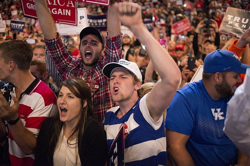 Supporters at a rally for Mr Trump on Oct 13 in Cincinnati, Ohio. The rhetoric in the campaigning has been unusually corrosive, unearthing old social, racial and geographic fault lines, and leaving many Americans and outsiders wondering at the future