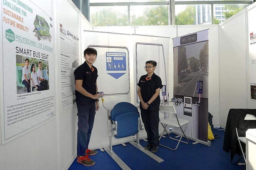 Linus Lim and Maizurah Razali with their Smart Bus Seat prototype, which cost $650 to build. Both ITE College Central students are sharing the $5,000 cash prize for the silver award. No one took the gold award.