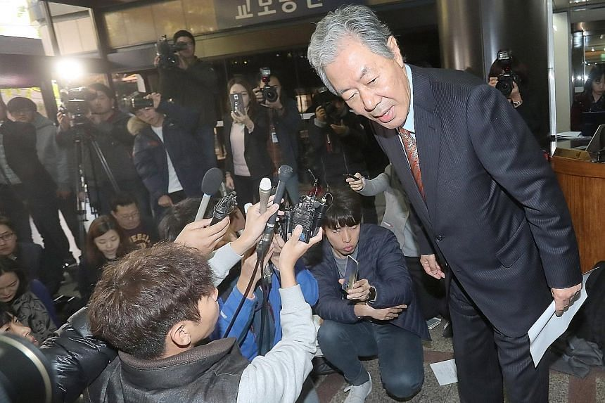 """Mr Lee Kyung Jae, lawyer for Ms Choi Soon Sil, leaving after a news conference in Seoul yesterday. He said Ms Choi """"expressed her deep apology to the people for letting them down and causing them frustration""""."""