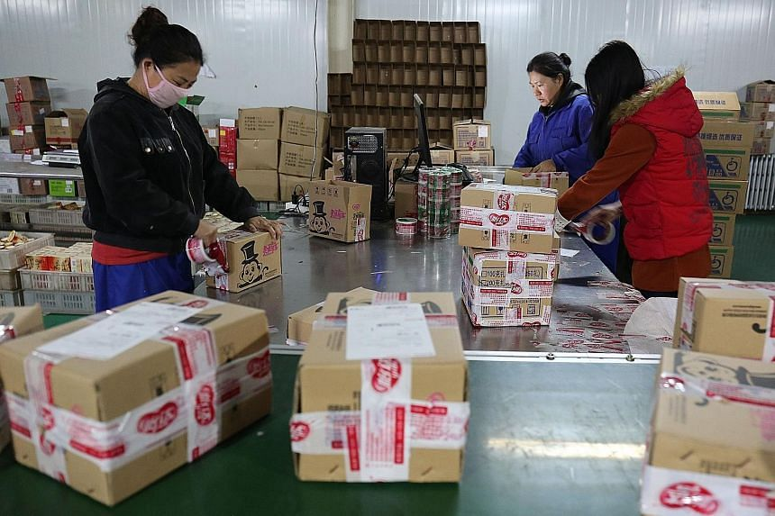 Workers packing products at a company in Hebei province. Enterprises across China are gearing up for the spike in sales ahead of this year's Singles' Day online shopping festival. The boom in e-commerce has created large amounts of parcel packaging w