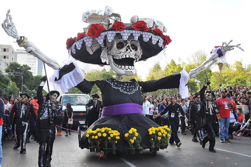 Floats with a death theme during Mexico City's Day of the Dead procession last Saturday inspired by the 2015 Bond movie Spectre.