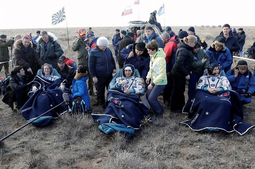 The Russian Soyuz MS space capsule after landing with the three ISS crew members who had spent 115 days aboard the International Space Station. The ISS crew members (from left) Kathleen Rubins of the US, Anatoly Ivanishin of Russia and Takuya Onishi
