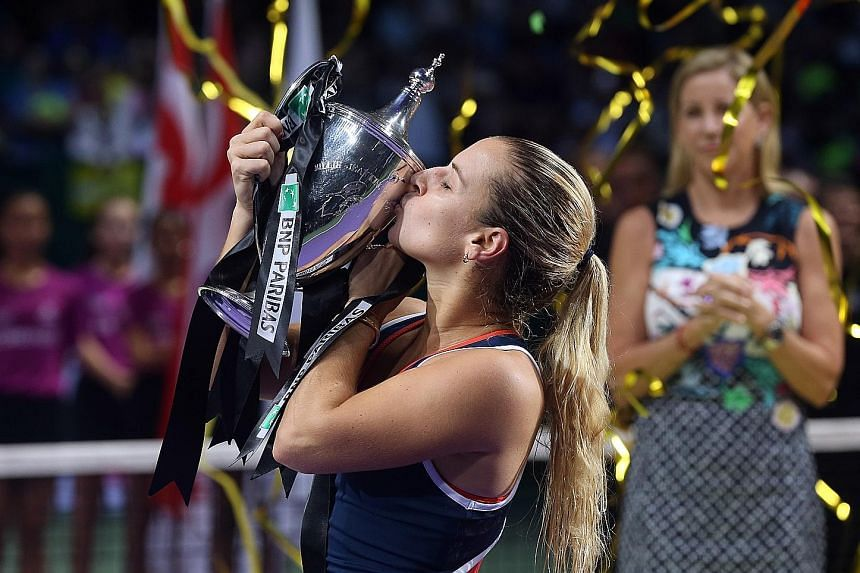 Slovakia's Dominika Cibulkova kissing the Billie Jean King trophy after winning the season-ending BNP Paribas WTA Finals Singapore presented by SC Global at the Singapore Indoor Stadium last night. The 27-year-old world No. 8 stunned world No. 1 Ange