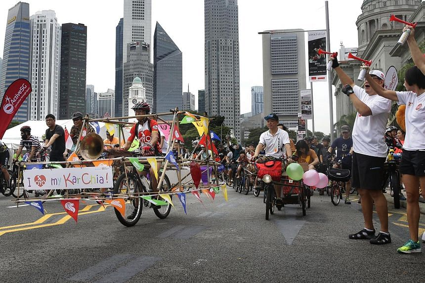 A cyclist and his bamboo-inspired bicycle joining other cycling enthusiasts at the flag-off yesterday for Car-Free Sunday, in front of the National Gallery Singapore. It was the first Car-Free Sunday after a three-month hiatus. The programme now cove
