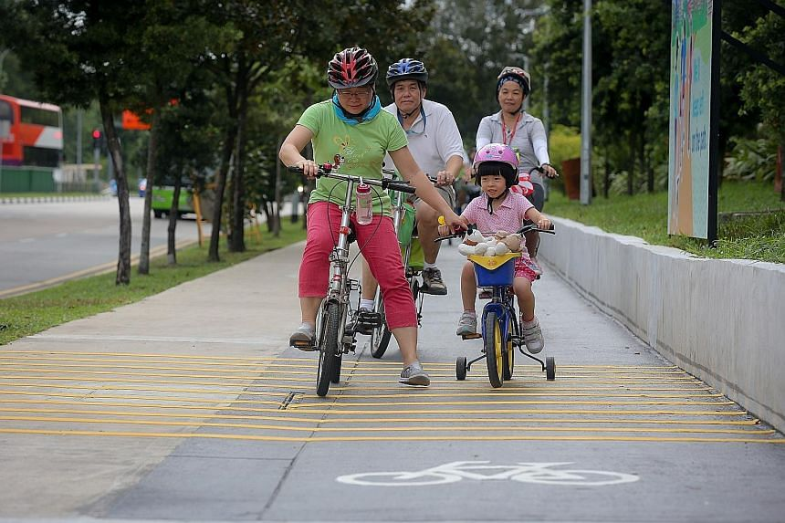 Young and old enjoying the new cycling paths yesterday. As Singapore's first eco-town, Punggol is also developing its waterfront spaces and amenities.