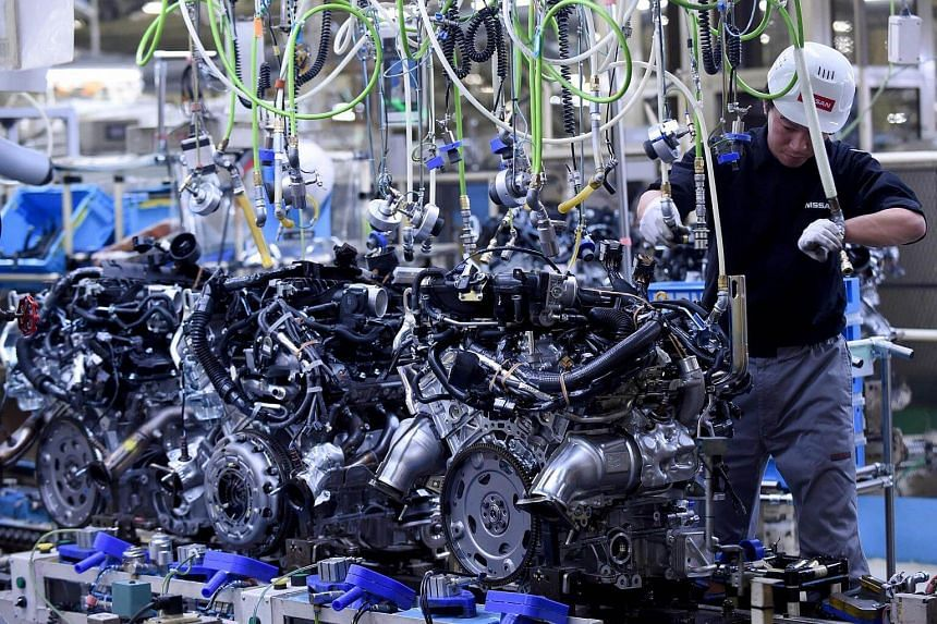 An employee working at the main assembly line of V6 engines at the Iwaki Plant of Japan's Nissan Motor in Iwaki, Fukushima prefecture, on April 5, 2016.