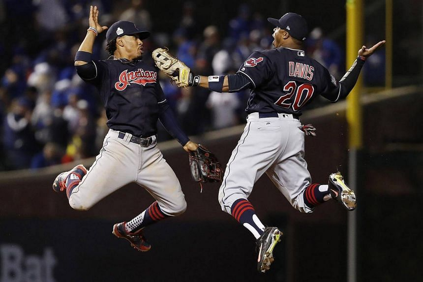 Cleveland Indians Francisco Lindor (left) and Rajai Davis (right) celebrate after defeating the Chicago Cubs in game four of the World Series between the Chicago Cubs and the Cleveland Indians at Wrigley Field in Chicago, Illinois, US, on Oct 29, 201