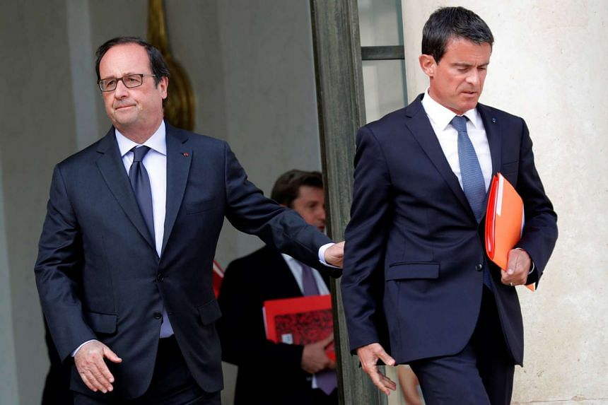 French President Francois Hollande (lrft) accompanies Prime Minister Manuel Valls at the end of a defence council at the Elysee Palace in Paris, France, in August.
