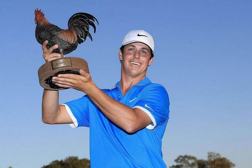 Cody Gribble posing with the trophy after winning the Final Round of the Sanderson Farms Championship at the Country Club of Jackson, on Oct 30, 2016.