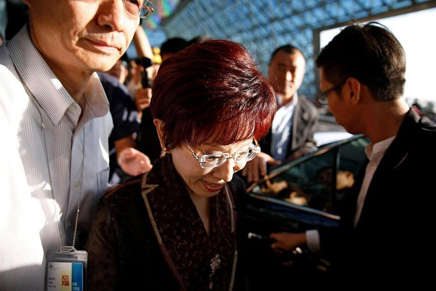 Nationalist Party, or Kuomintang (KMT), chairman Hung Hsiu-chu arrives at the airport in Taoyuan, Taiwan, for her first trip to China, where she is expected to meet China's President Xi Jinping, on Oct 30, 2016.