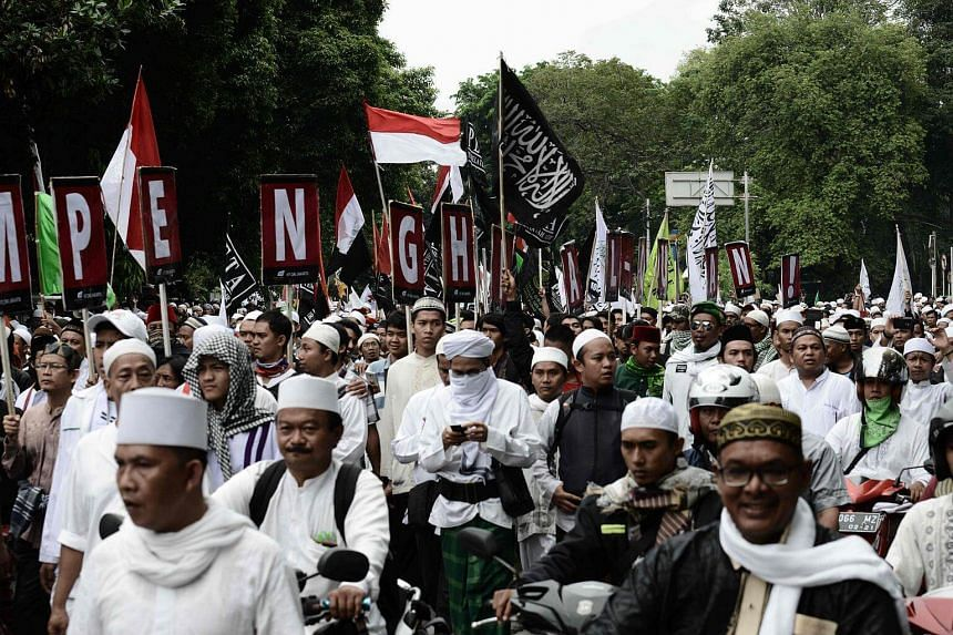 Thousands of Indonesian Muslims marching in protest against Jakarta governor Basuki Tjahaja Purnama outside his office in Jakarta, on Oct 14, 2016.