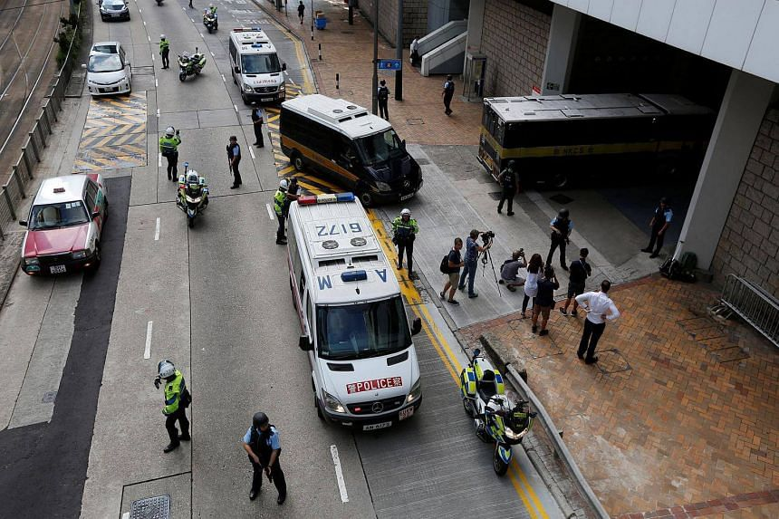 Armed policemen guard the entrance as a prison car carrying British former banker Rurik Jutting enters High Court in Hong Kong, China on Oct 25, 2016.