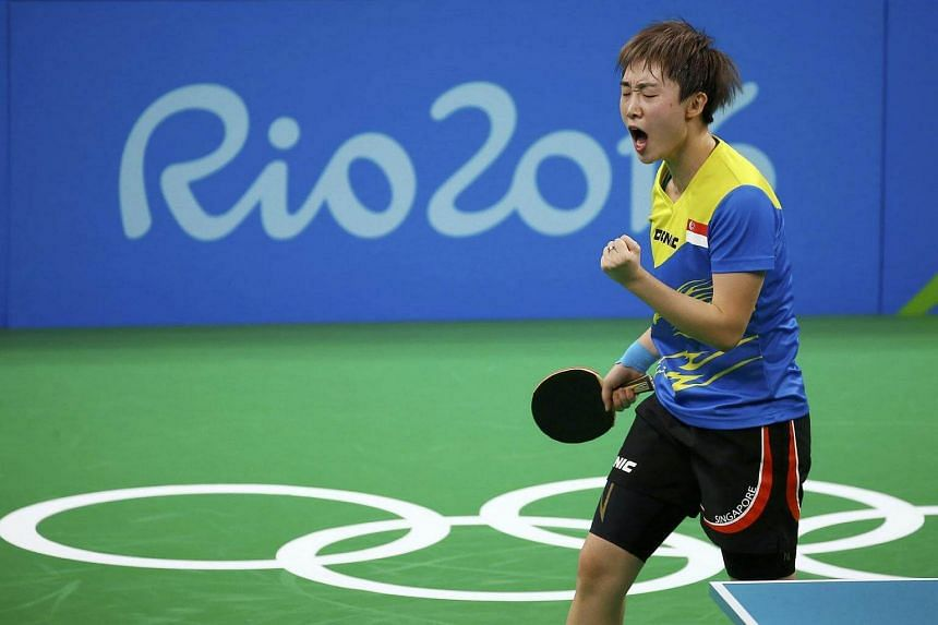 Feng Tianwei of Singapore celebrates after winning her match against Xialian Ni of Luxembourg.