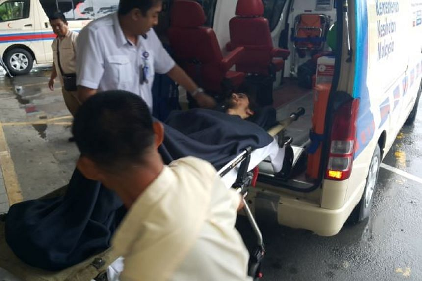 Australian tourist Andrew Gaskell being placed in an ambulance after being found in Mulu National Park.