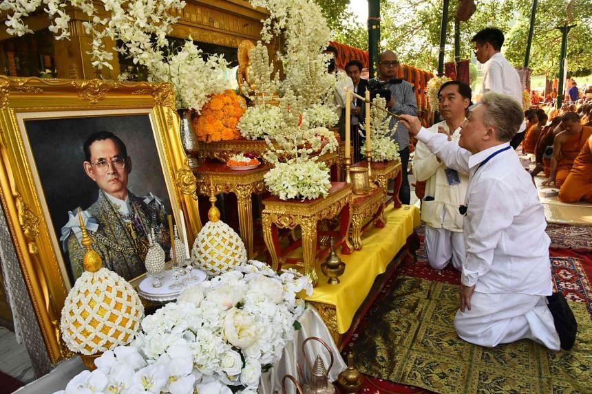 Thai devotees offer special prayers under the sacred Bodhi Tree for the soul of the late Thai King Bhumibol Adulyadej at Bodhgaya on Oct 30, 2016.