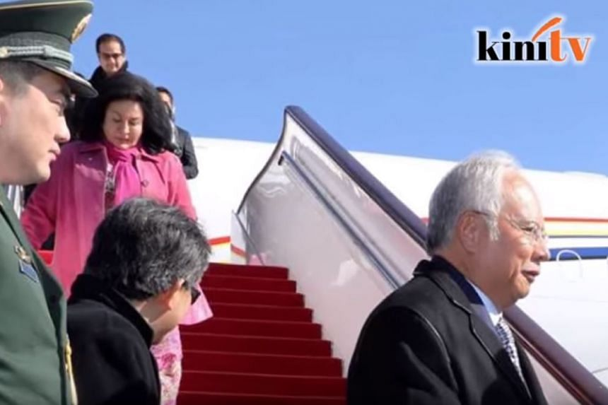 A controversy has broken out over video images of PM Najib Razak landing in Beijing on Monday for a weeklong visit, when one of the passengers coming down the Malaysian government jet was Najib's stepson, Riza Aziz.