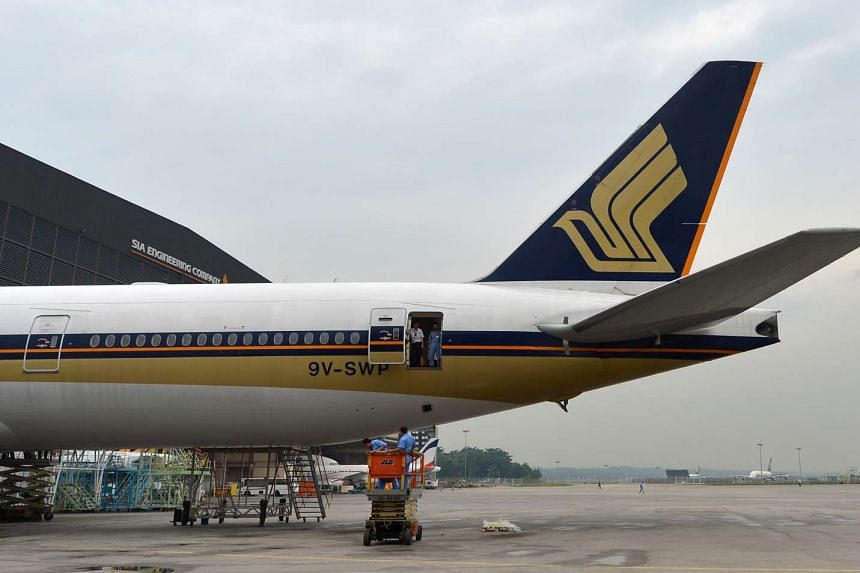 A Singapore Airlines Boeing 777-300 is seen parked in the SIA Engineering Company hangar at Changi on Sept 25, 2013.