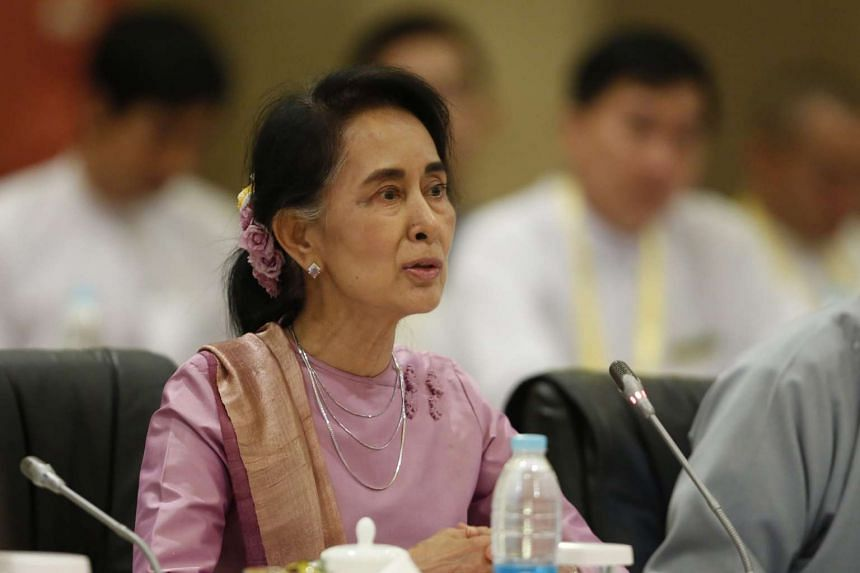 State Counsellor of Myanmar Aung San Suu Kyi speaks to members of the Union Peace Dialogue Joint Committee during their meeting in Naypyitaw, Myanmar, on Oct 28, 2016.