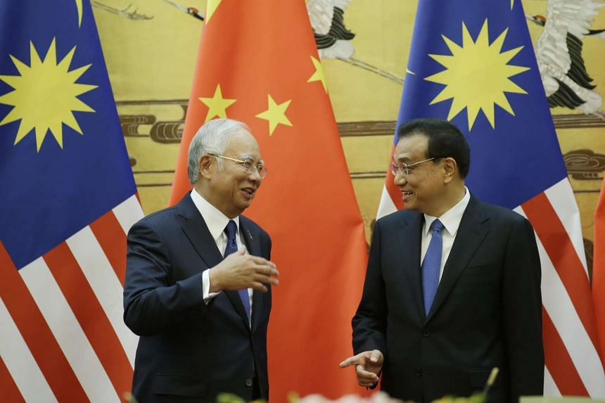 Malaysia's Prime Minister Najib Razak (left) and China's Premier Li Keqiang attend a signing ceremony at the Great Hall of the People in Beijing on Nov 1, 2016.