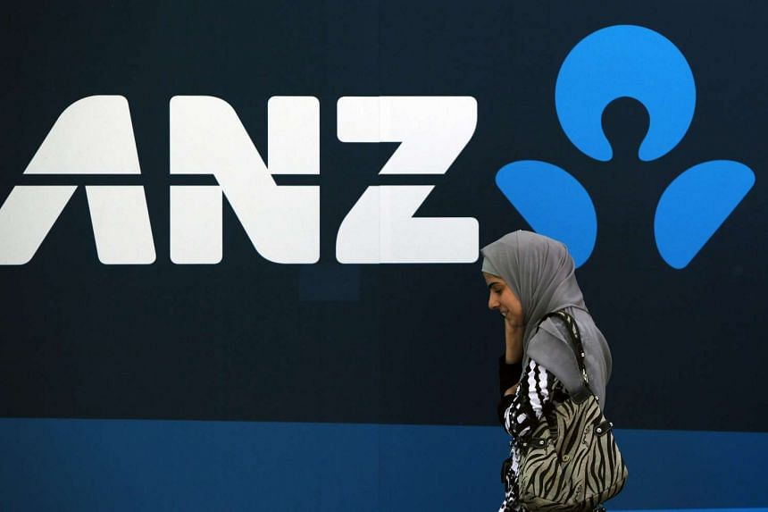 A woman walking past an Australia and New Zealand Banking Group branch in central Sydney.