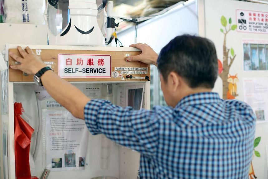 """Operating on """"honesty', the provision shop in Hougang has a """"robot cash register"""" that allows customers to pay for their own items and give themselves change."""