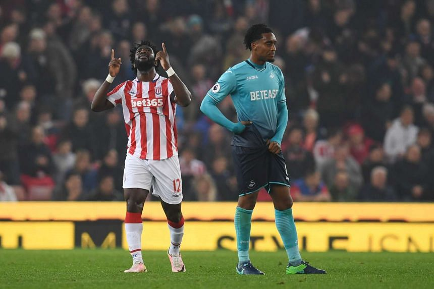 Wilfried Bony (left) celebrates after scoring during the English Premier League football match between Stoke City and Swansea.