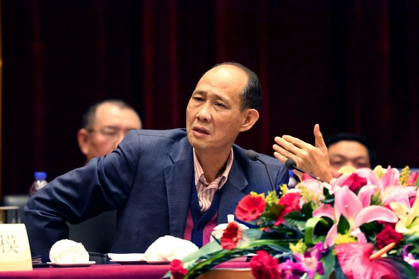 Huang Rulun, head of Century Golden Resources Group attends a meeting in Lianjiang, China.