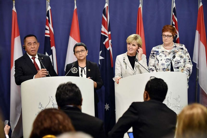 Australia's Foreign Minister Julie Bishop (second from right) and Defence Minister Marise Payne (right) at a press conference with their Indonesian counterparts Retno Marsudi (second from left) and Ryamizard Ryacudu in Sydney on Dec 21, 2015.