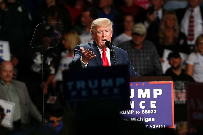 US Republican presidential candidate Donald Trump addresses supporters at Macomb Community College on Oct 31, 2016 in Warren, Michigan.