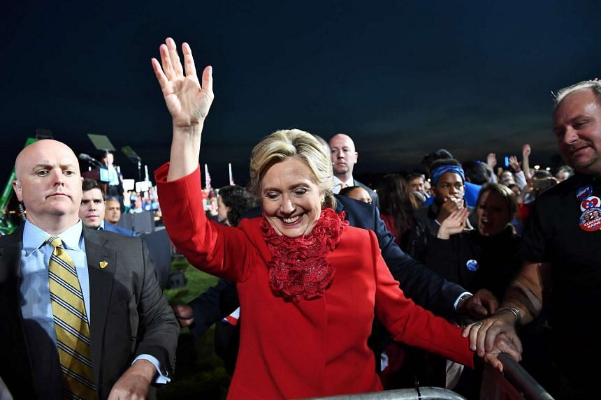 US Democratic presidential candidate Hillary Clinton waving to supporters during a rally in Cincinnati, Ohio, on Oct 31, 2016.