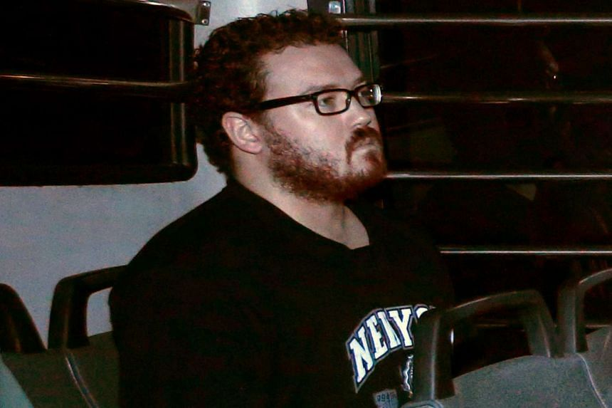 Rurik George Caton Jutting, a British banker charged with two counts of murder after police found the bodies of two women in his apartment, in the back row of a prison bus at the Eastern Law Courts in Hong Kong on Nov 24, 2014.