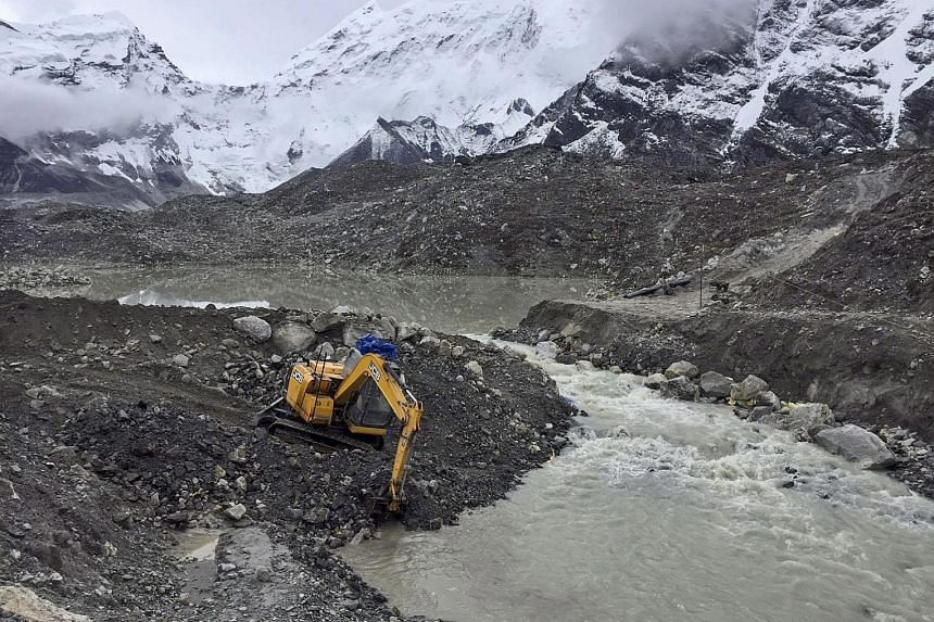 Imja Tsho, nearly 150m deep, had its water level lowered by 3.5m after six months of rigorous work. Scientists say climate change is causing the Himalayan glaciers to melt at an alarming rate, creating huge glacial lakes which could burst their banks