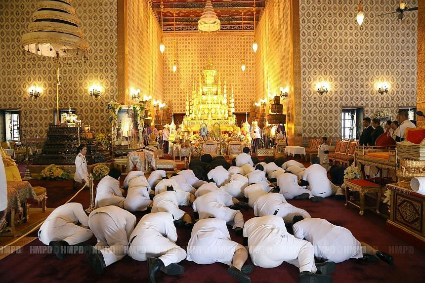 Mourners paying their respects to Thailand's late King Bhumibol Adulyadej in the Grand Palace in Bangkok on Sunday. Crown Prince Maha Vajiralongkorn will return from Germany this month, said a senior military source.