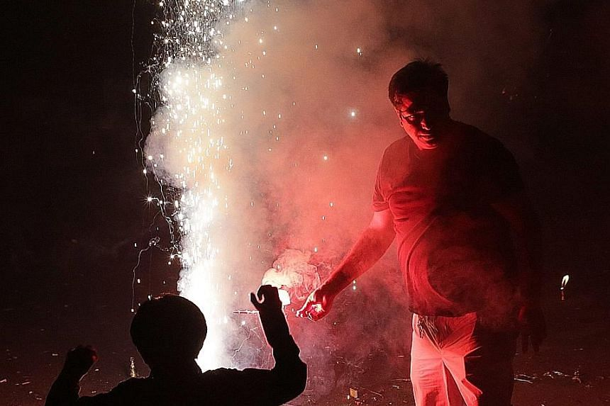 Firecrackers being lit during Diwali festivities near New Delhi on Sunday. Pollution levels surge at this time traditionally, but the authorities said it was worse this year due to high levels of moisture in the air and the burning of agricultural re