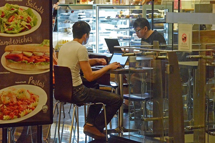 Coffee Bean and Tea Leaf customers at the HDB Hub. The IMDA said about two million unique users a month log in to Wireless@SG services.