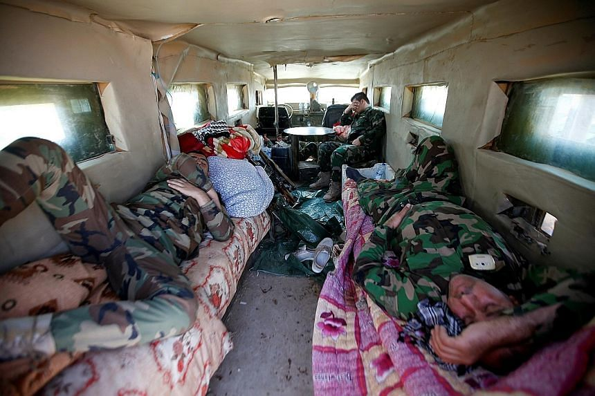Peshmerga fighters resting on Sunday in a military vehicle on the outskirts of Bashiqa, east of Mosul, amid an ongoing operation against ISIS militants in Iraq. The capture of Mosul would mark the ISIS militants' effective defeat in the Iraqi half of