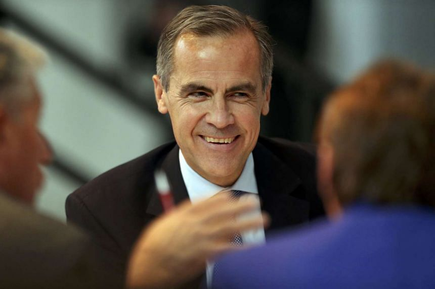 British Prime Minister Theresa May has thrown her weight behind Bank of England governor Mark Carney.