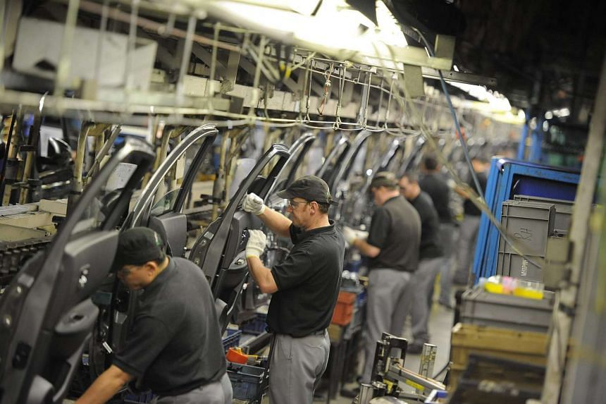 Nissan technicians prepare doors for the Qashqai car at the company's plant in Sunderland, northern England.