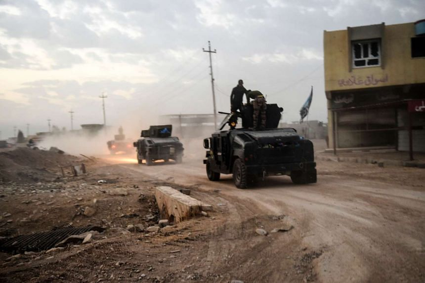 Members of the Iraqi Counter Terrorism Service (CTS) driving near the village of Bazwaya, on the eastern edges of Mosul, on Oct 31, 2016.