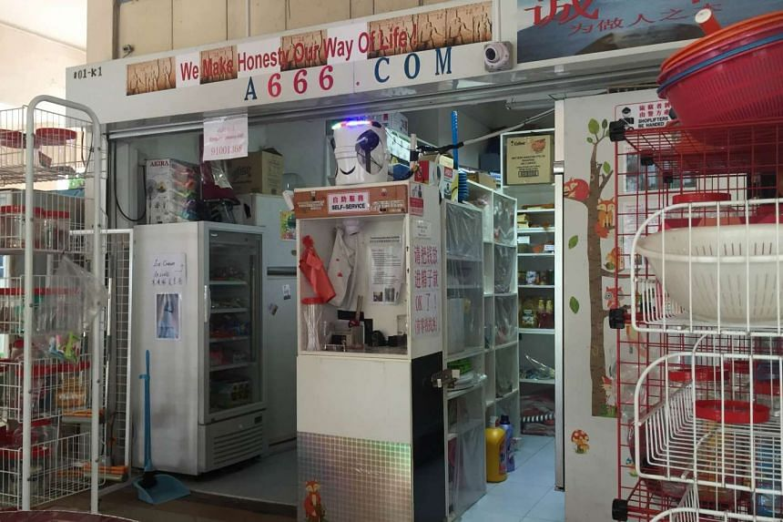 The self-service provision shop located at 242 Hougang Street 22 does not rely on staff for payment collection and instead, entrusts customers to drop in payment of merchandise at a booth.