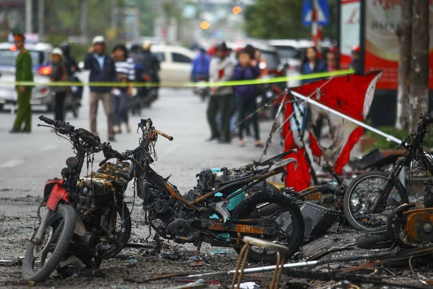 Damaged motorcycles that were burnt in a fire that started in a karaoke bar are seen in Hanoi on Nov 2, 2016.